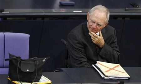 German Finance Minister Wolfgang Schaeuble attends a session of the Bundestag, the lower house of parliament, before a vote on a Spanish bank aid package in Berlin, July 19, 2012. REUTERS/Thomas Peter