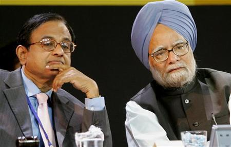 Prime Minister Manmohan Singh (R) speaks with Palaniappan Chidambaram during a seminar at the Asian Development Bank annual meeting in Hyderabad May 5, 2006. REUTERS/Punit Paranjpe/Files