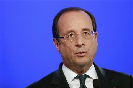France's President Francois Hollande delivers a speech during a visit at a school in Trappes, west of Paris, September 3, 2012, the day before the start of the new school year. REUTERS/Thibault Camus/Pool