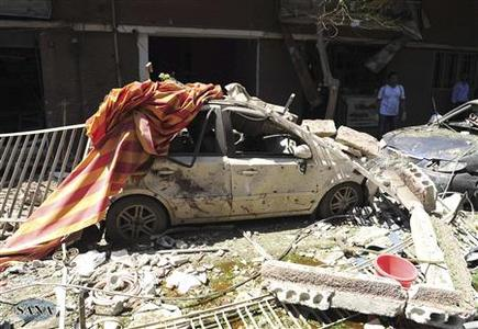 A view shows the wreckage after a car bomb exploded in the Jaramana district of southeast Damascus September 3, 2012, in this handout photograph released by Syria's national news agency SANA. A car bomb exploded on Monday in a religiously mixed district on the edge of the Syrian capital Damascus, state media and opposition campaigners said.The Local Coordination Committees said ambulances were ferrying wounded people from the Wihdeh roundabout in Jaramanah after the explosion. State news agency SANA said the wounded included women and children. REUTERS/SANA