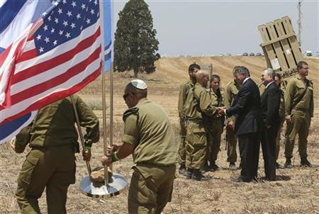 U.S. Defense Secretary Leon Panetta and Israeli Defense Minister Ehud Barak greet Israeli soldiers after a joint news conference during a visit to the Iron Dome defense system launch site in Ashkelon August 1, 2012. REUTERS/Mark Wilson/Pool