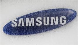<p>Foto de archivo del logo de la firma Samsung Electronics en su casa matriz de Seúl, jul 6 2012. Samsung Electronics dijo el lunes que realizará inspecciones en 250 compañías chinas que hacen productos para la firma, con el fin de garantizar que no se violen leyes laborales luego de que un grupo con sede en Estados Unidos acusara a uno de sus proveedores de trabajo infantil. REUTERS/Lee Jae-Won</p>
