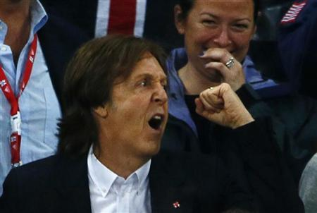 Former Beatle Paul McCartney watches the athletics events during the London 2012 Olympic Games at the Olympic Stadium August 4, 2012. REUTERS/Kai Pfaffenbach