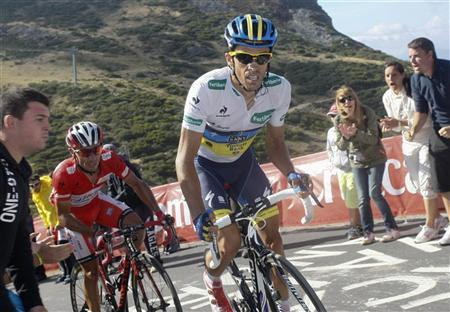 Katusha Team rider and leader of the race Joaquim ''Purito'' Rodriguez (L) of Spain and Team Saxo Bank rider Alberto Contador of Spain cycle during the 16th stage of the Tour of Spain ''La Vuelta'' cycling race between Gijon and Valgrande-Pajares Cuitunigru September 3, 2012. REUTERS/Joseba Etxaburu