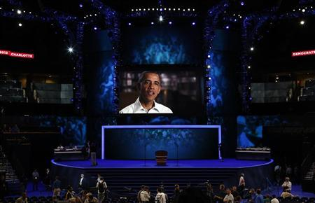 U.S. President Barack Obama is seen on a video screen during preparations at the venue for the Democratic National Convention in Charlotte, North Carolina, September 3, 2012. REUTERS/Jason Reed