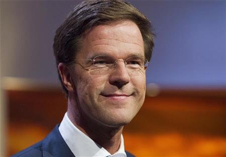 Dutch Prime Minister and Dutch Liberal Party leader Mark Rutte smiles during a political debate in Hilversum August 30, 2012. REUTERS/Michael Kooren
