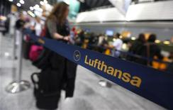 Passengers wait in front of a counter of German air carrier Lufthansa at the Fraport airport in Frankfurt, August 31, 2012. REUTERS/Kai Pfaffenbach