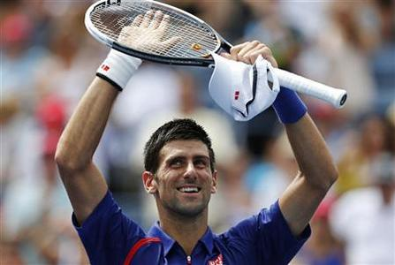 Novak Djokovic of Serbia celebrates after defeating Julien Benneteau of France during their men's singles match at the U.S. Open tennis tournament in New York September 2, 2012. REUTERS/Eduardo Munoz