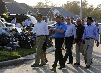 U.S. President Barack Obama (front L) is joined by Louisiana Governor Bobby Jindal (R) as they tour Hurricane Isaac damage in the Ridgewood neighborhood of LaPlace, Saint John the Baptist Parish in Louisiana, September 3, 2012. REUTERS/Larry Downing