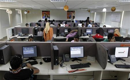 Employees work at a call centre on the outskirts of Srinagar, August 2, 2011. REUTERS/Fayaz Kabli/Files