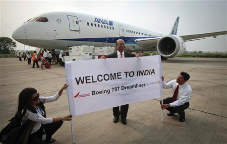 Boeing India President Dinesh Keskar (C) poses in front of the Boeing 787 Dreamliner aircraft for All Nippon Airways (ANA) after its India debut landing at the Indira Gandhi international airport in New Delhi, in this July 13, 2011 file photo. REUTERS/B Mathur/Files