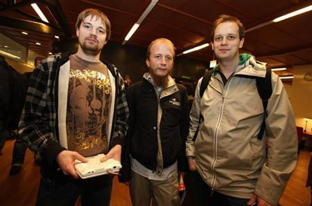 Pirate Bay co-founders Fredrik Neij (L), Gottfrid Svartholm (C) and Peter Sunde leave the city court after the last day of argument's in their copyright trial in Stockholm March 3, 2009. REUTERS/Bob Strong