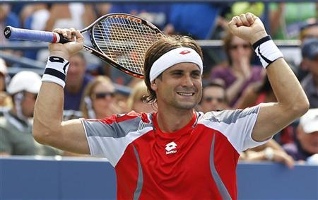 David Ferrer of Spain celebrates after defeating Lleyton Hewitt of Australia in their men's singles match at the U.S. Open tennis tournament in New York September 2, 2012. REUTERS/Gary Hershorn