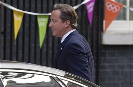 Britain's Prime Minister David Cameron arrives at Downing Street in London, September 4, 2012. REUTERS/Neil Hall