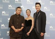 """Director Kim Ki-duk (L) poses with actors Lee Jung-jin (R) and Jo Min-soo during the photocall of the movie """"Pieta"""" at the 69th Venice Film Festival in Venice September 4, 2012. REUTERS/Tony Gentile"""