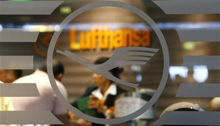 An employee of German air carrier Lufthansa is seen through a window at a rebooking counter at the Fraport airport in Frankfurt, September 4, 2012. REUTERS/Kai Pfaffenbach