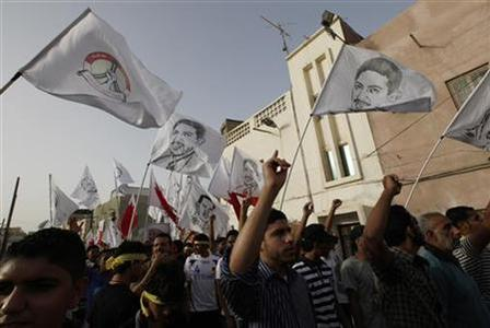 Protesters holding white flags with pictures of Bahraini Human Rights Activist, Abdulhadi al-Khawaja, participate in a 40th-day (Arbaoon) funeral procession of Salah Abbas Habib in the village of Bilad al-Qadeem west of Manama, June 2, 2012. REUTERS/Hamad I Mohammed