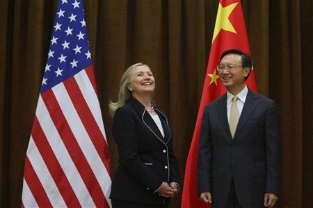 U.S. Secretary of State Hillary Clinton and China's Foreign Minister Yang Jiechi (R) smile during their meeting in Beijing September 4, 2012. REUTERS/Feng Li/Pool
