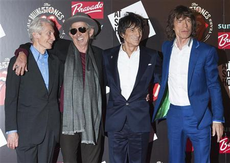 The Rolling Stones (L-R) Charlie Watts, Keith Richards, Ronnie Wood and Mick Jagger pose as they arrive for the opening of the exhibition ''Rolling Stones: 50'' at Somerset House in London July 12, 2012. REUTERS/Ki Price