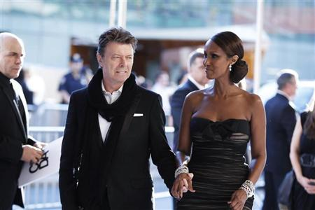 Singer David Bowie arrives with his wife Iman to attend the Council of Fashion Designers of America (CFDA) fashion awards in New York June 7, 2010. REUTERS/Lucas Jackson