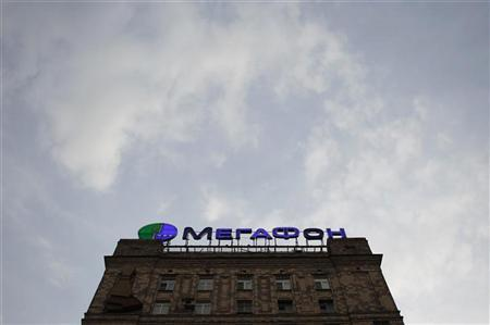 The logo of Russian mobile operator Megafon is seen from the roof of a residential building in Moscow April 25, 2012. REUTERS/Maxim Shemetov