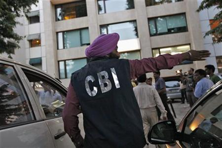 A Central Bureau of Investigation (CBI) official gestures outside the New Delhi office of the Abhijeet Group, which owns Jas Infrastructure, after conducting a raid on September 4, 2012. REUTERS/Mansi Thapliyal