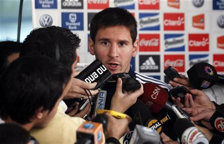 Argentina's striker Lionel Messi talks to journalists after a training session ahead of their 2014 World Cup qualifying match against Paraguay in Buenos Aires, September 4, 2012. REUTERS/Marcos Brindicci