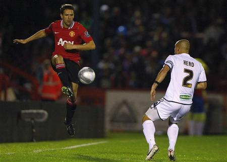 Ben Herd (R) of Aldershot Town watches as Michael Owen of Manchester United controls the ball during their League Cup match at the EBB Stadium in Aldershot, England, October 25, 2011. REUTERS/Andrew Winning