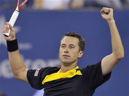 Philipp Kohlschreiber of Germany celebrates in the fifth set after defeating John Isner of the U.S. at the US Open men's singles tennis tournament in New York, September 2, 2012. REUTERS/Bill Kostroun