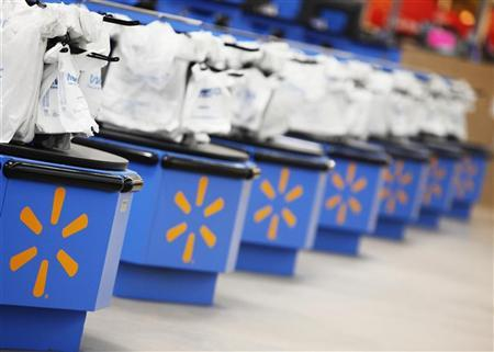 The Wal-Mart logo is pictured on cash registers at a new store in Chicago, January 24, 2012. The store will open on January 25, and it will be Wal-Mart's largest outlet in Chicago. REUTERS/John Gress