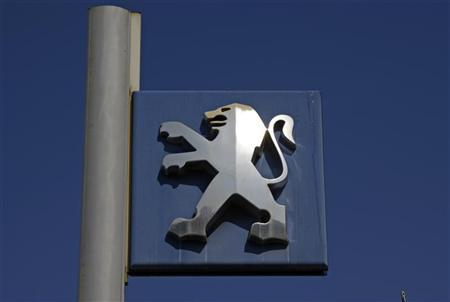 The Peugeot logo is seen at the entrance of a car dealership in Nice, southern France, July 19, 2012. REUTERS/Eric Gaillard