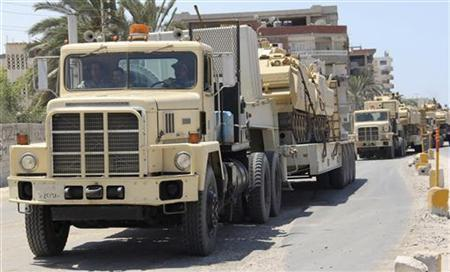 Egyptian army trucks carrying tanks and vehicles, expecting opposition against militants, arrive at Rafah city, some 350 km (217 miles) northeast of Cairo August 9, 2012 . REUTERS/Stringer