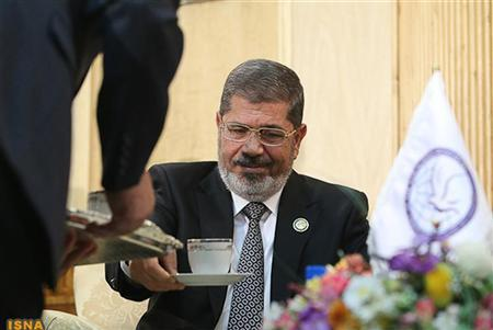 Egypt's President Mohamed Mursi is seen before his meeting with Iran's Executive Vice President Hamid Baghai at Mehrabad airport in Tehran ahead of the 16th summit of the Non-Aligned Movement, August 30, 2012. REUTERS/Roohollah Vahdati/ISNA