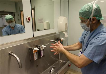 A surgeon washes his hands at a hospital in Berlin February 29, 2008. REUTERS/Fabrizio Bensch