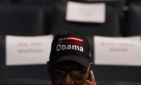 A delegate wearing a cap supporting President Barack Obama awaits the start of the first day of the Democratic National Convention in Charlotte, North Carolina September 4, 2012. REUTERS/Eric Thayer