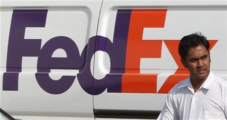 A man walks past a FedEx vehicle at the company's office in Dubai October 30, 2010. REUTERS/Ahmed Jadallah