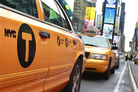 A New York City taxicab drives through Times Square in New York, September 4, 2012. REUTERS/Brendan McDermid