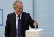 Quebec Liberal leader Jean Charest casts his vote in his home riding in Sherbrooke, Quebec, September 4, 2012. REUTERS/Olivier Jean