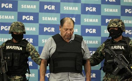Mexican marines escort Mario Cardenas Guillen (R), alias ''El Gordo or El M-1'', as he is presented to the media in Mexico City September 4, 2012. REUTERS/Henry Romero