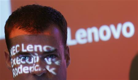 Roderick Lappin, vice president of Lenovo Group and executive chairman of Lenovo NEC Holdings poses in front of a screen where his name and the company's logo are projected, prior to his interview in Tokyo September 5, 2012. Shares of PC maker Lenovo Group Ltd dropped as much as 8.1 percent on Wednesday after Japan's cash-strapped NEC Corp sold its entire stake in the company in a deal worth 18 billion yen ($229.62 million). ''In reality, NEC could sell those shares after two years anyway as per contract. All we have done is to let them do it 10 months earlier. This has no bearing on our joint venture,'' said Lappin. REUTERS/Kim Kyung-Hoon