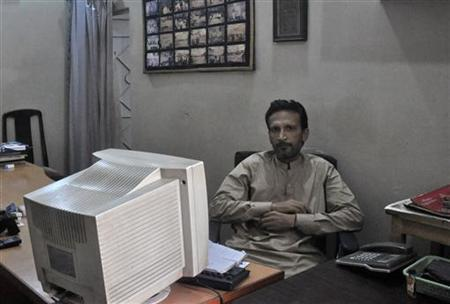 Fida Dashti, brother of Abdul Rehman Dashti, is photographed in a friend's office in Karachi August 2, 2012. REUTERS/Stringer/Files
