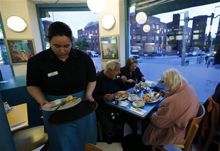 Customers are seen dining at Mr Fish in north London May 22, 2012. REUTERS/Eddie Keogh
