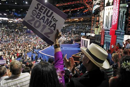 Delegates react during the first day of the Democratic National Convention in Charlotte, North Carolina, September 4, 2012. REUTERS/Jessica Rinaldi