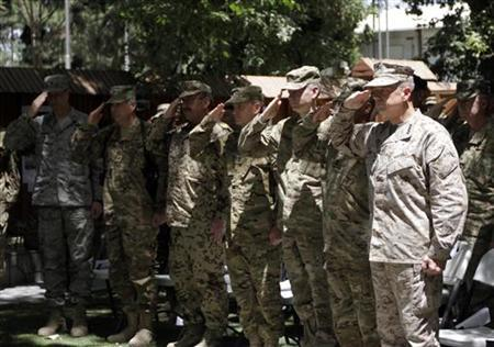 U.S. General John Allen (front R), commander of the North Atlantic Treaty Organization (NATO) forces in Afghanistan, and other military personnel stand at attention during U.S. Independence Day celebrations in Kabul July 4, 2012. REUTERS/Mohammad Ismail