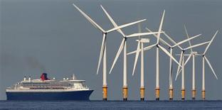 The cruise liner Queen Mary 2 passes the Burbo Bank off-shore wind farm as it heads to Liverpool, northern England in this September 15, 2011 file photograph. REUTERS/Phil Noble/Files