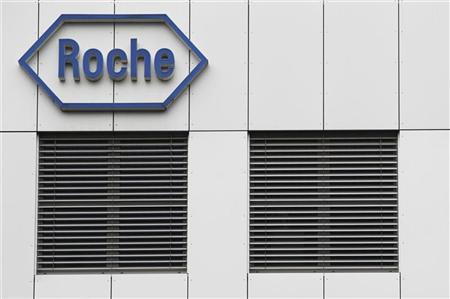 The logo of the Swiss drugmaker Roche is seen on a factory in Burgdorf near Bern November 17, 2010. REUTERS/Pascal Lauener
