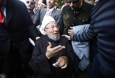 Egyptian cleric Sheikh Yousef al-Qaradawi arrives to lead the Friday prayers in Tahrir Square in Cairo February 18, 2011. REUTERS/Suhaib Salem