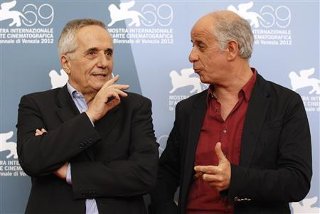 Director Marco Bellocchio (L) and cast member Toni Servillo pose during the photocall of the movie ''Bella addormentata'' (Dormant Beauty) at the 69th Venice Film Festival in Venice September 5, 2012. REUTERS/Tony Gentile