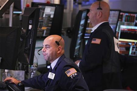 Traders on the floor of the New York Stock Exchange look at their trading screens in New York August 31, 2012. REUTERS/Lucas Jackson