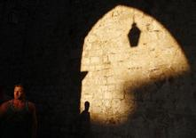 A man walks in Croatia's UNESCO protected medieval town of Dubrovnik August 28, 2012. REUTERS/Marko Djurica